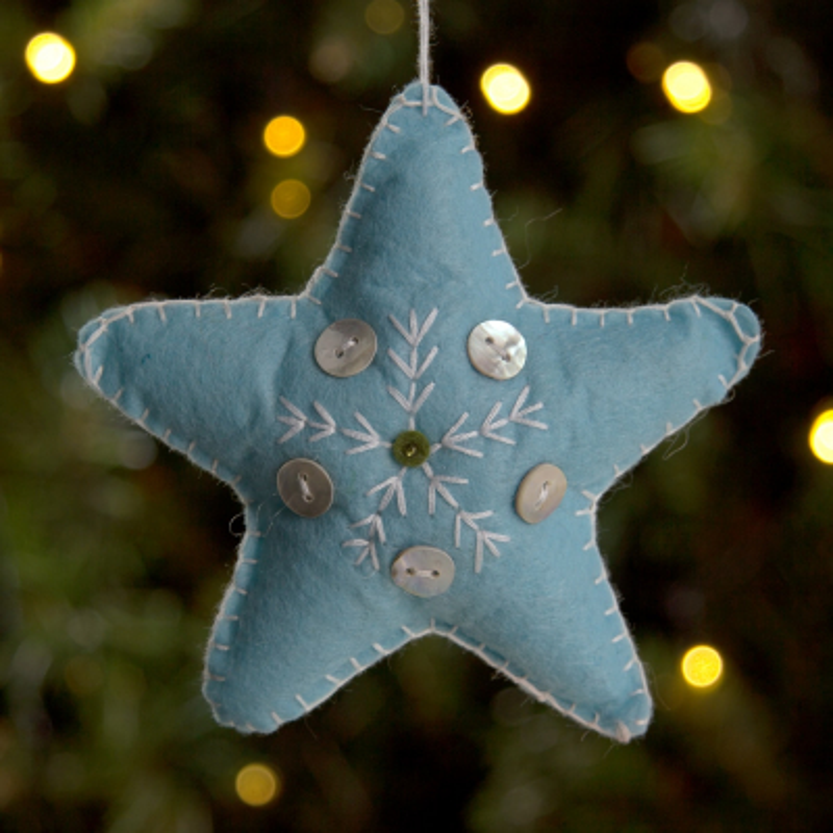 Vilten ster 11cm ijsblauw